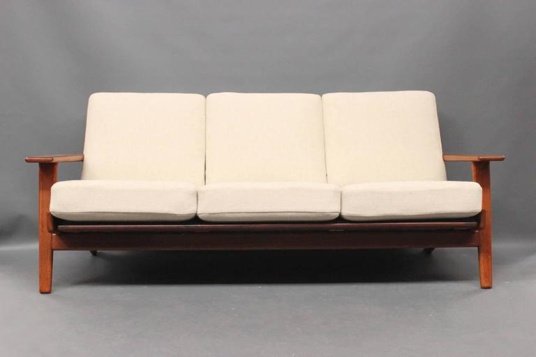 Hans J. Wegner sofa model GE290. Manufactured at GETAMA. The sofa is in teak and reupholstered in wool from Hallingdal.