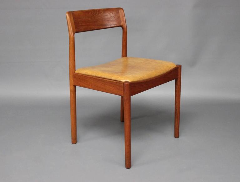 A set of six dining room chairs in teak and light brown leather. The chairs were designed by N.O. Møller and manufactured by J.L. Moeller in the 1960s.