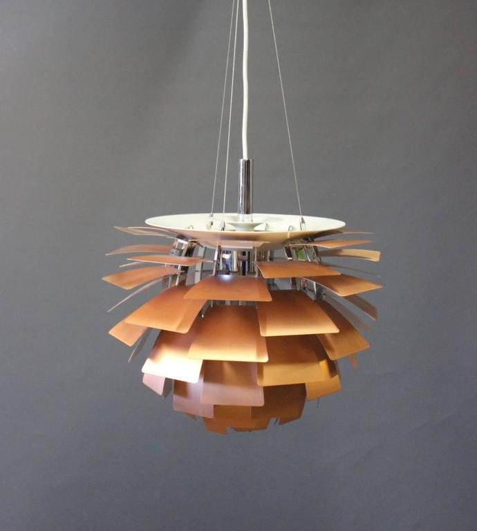 An all time eye catcher in lightning design. This copper version of Poul Henningsen's Artichoke measures 48 cm in diameter. This item is therefor very usable over a dining table.