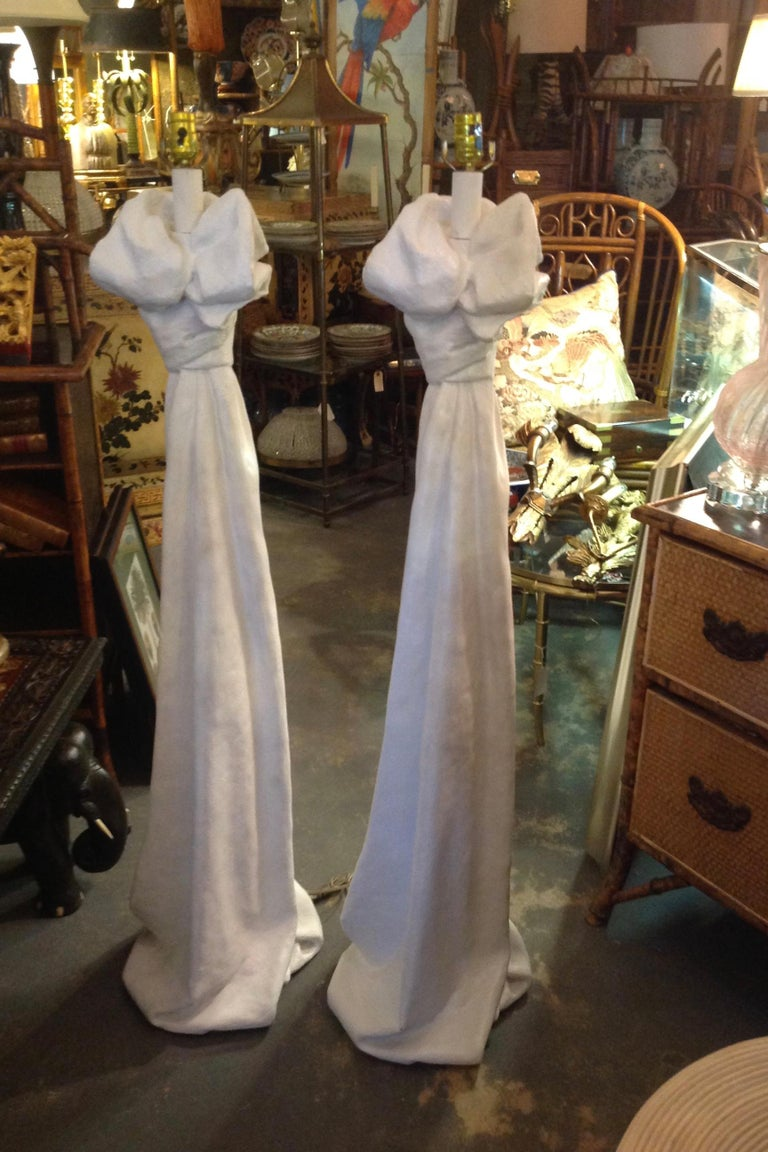 Classic knotted draperies fashioned after the iconic designer. Nice white satin finish. Measured to socket top.