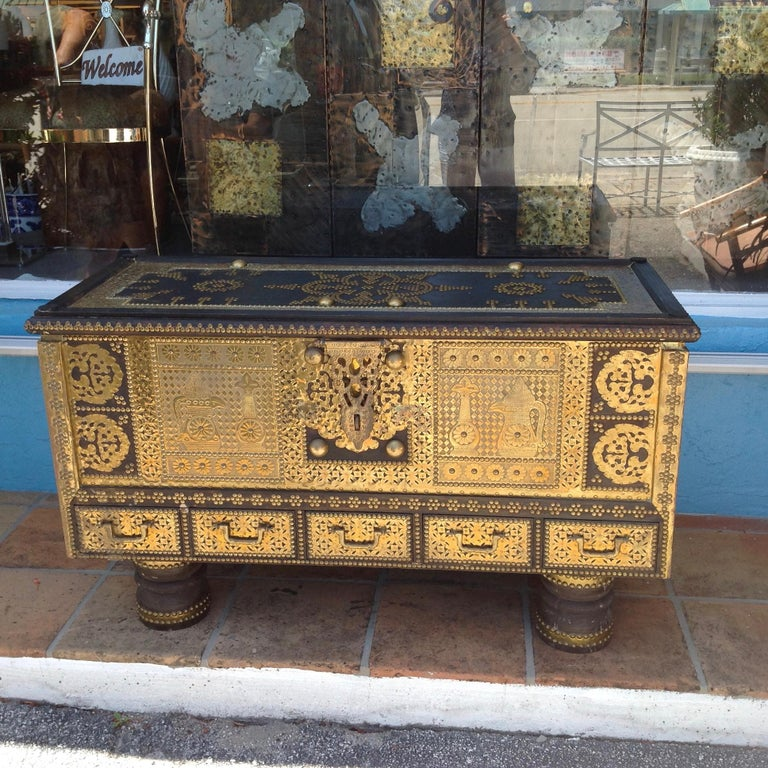 Ideally scaled as a coffee table with extensive brass overlays