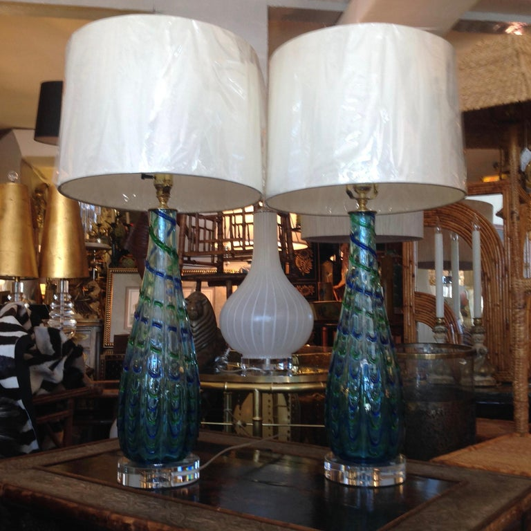 Beautiful pair of 1960s Murano handblown glass lamps with a peacock feathered design pattern.
