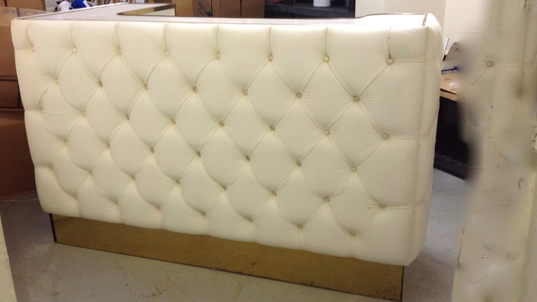 One of a kind with plush tufted leather front panels.