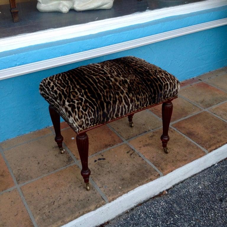 Visually stunning with a fresh hide cover. Fine mahogany framework raised upon original castors.
