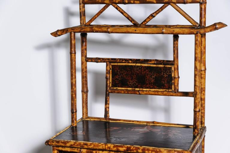 "Finely fashioned with an ""étagère"" top appointed with lacquer work."