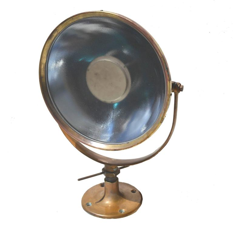 Fully operational Wilmot Castle searchlight, circa 1930s or 1940s in polished brass and copper. Would make wonderful Industrial lighting fixture in either Industrial or commercial installation. Most likely used by the U.S. Navy. Adjustable up, down