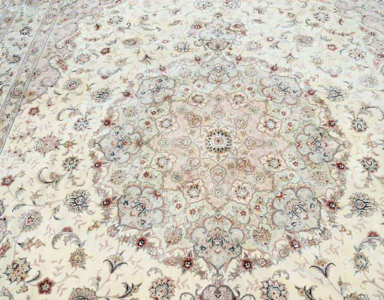 Beautiful Kashan Persian style wool rug with silk highlights by expert weavers from the Turkey/Pakistan/Turkmenistan region, circa 2000. High knot content and superior wool quality makes this is a very special rug. Pastel shades in champagne