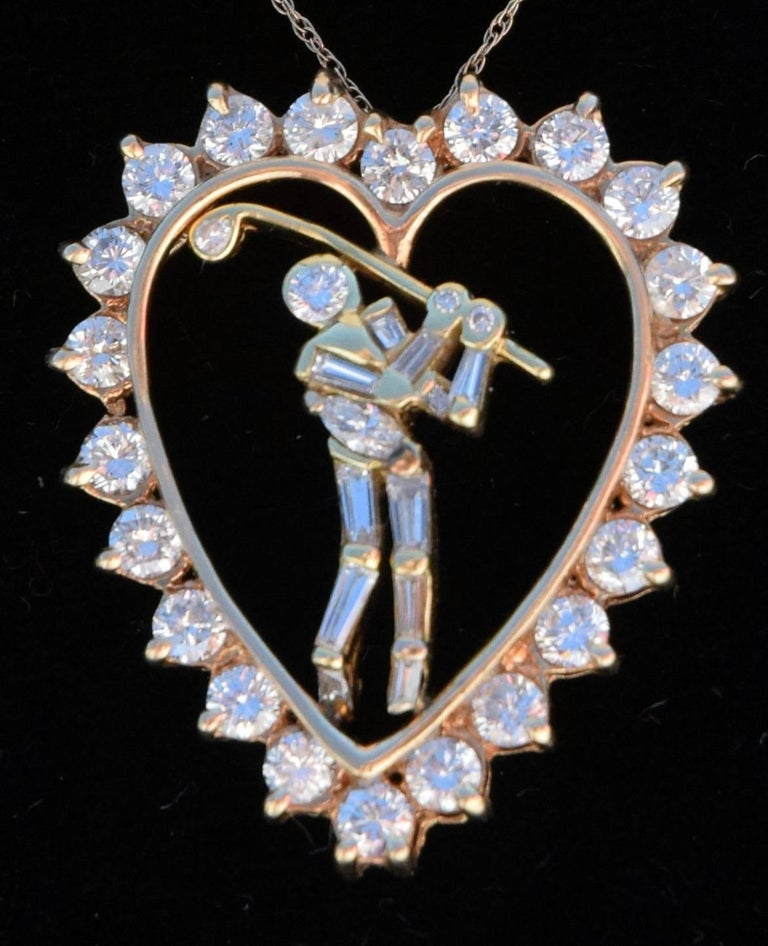 A Jose Hess jewelry designer masterpiece, circa 1990 era diamond pendant in the signature Golfer and Heart design. The heart has 22- round brilliant diamonds for Approximately 1.86 Carats, VS2 Clarity, G-H color and the Golfer has 11 Baguette