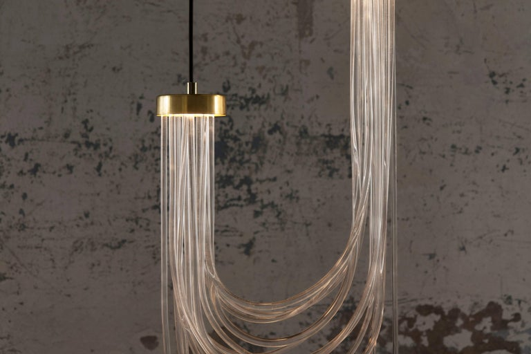 Double Cascade Pendant lamp Materials: polished brass, pmma, LED light Dimensions: 90 x 40 x 10 cm (variable) light source: 2xLED boards 500 mA - 12,4 w (max) - 3.000 k - 1.770 lm driver: external (AC 220v/ DC 24v)  Cascade tells about the