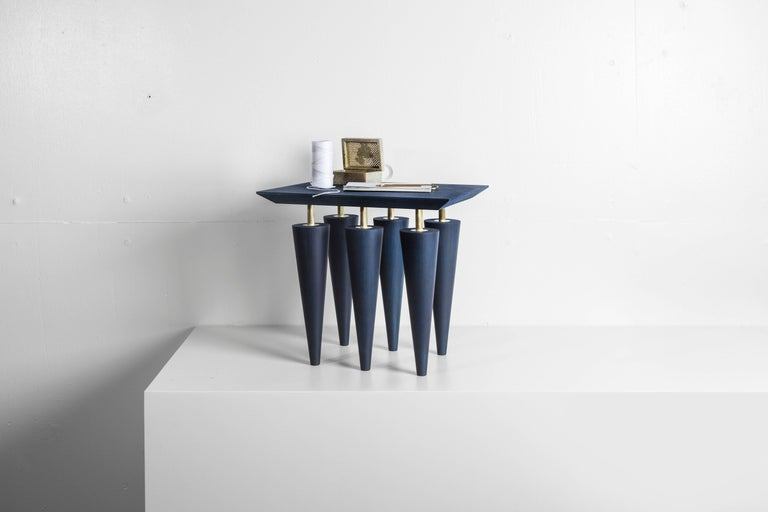 Blue birchwood and brass coffee table, Zwei design Top: Multiplex birch plywood with birchwood veneer Legs: Solid birchwood Detailing: Hand brushed brass Dimensions: 366 mm x 410 mm x 330 mm  Talitha and Michael Bainbridge are a German and