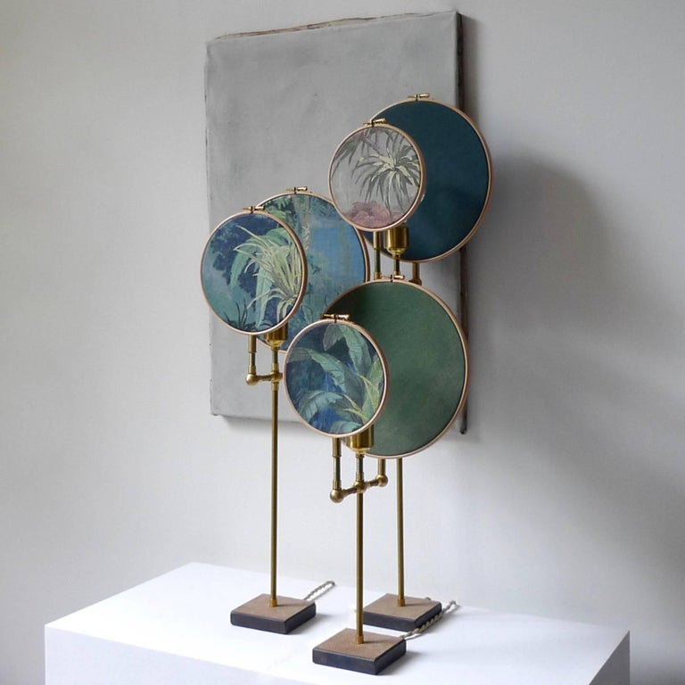 Ensemble of three table lamps, Sander Bottinga Handmade in brass, leather, wood, hand printed and painted linen. A dimmer is inlaid with leather Dimensions: H 83 x W 27 x D 16 cm H 68 x W 27 x D 16 cm H 55 x W 27 x D 16 cm The design artwork