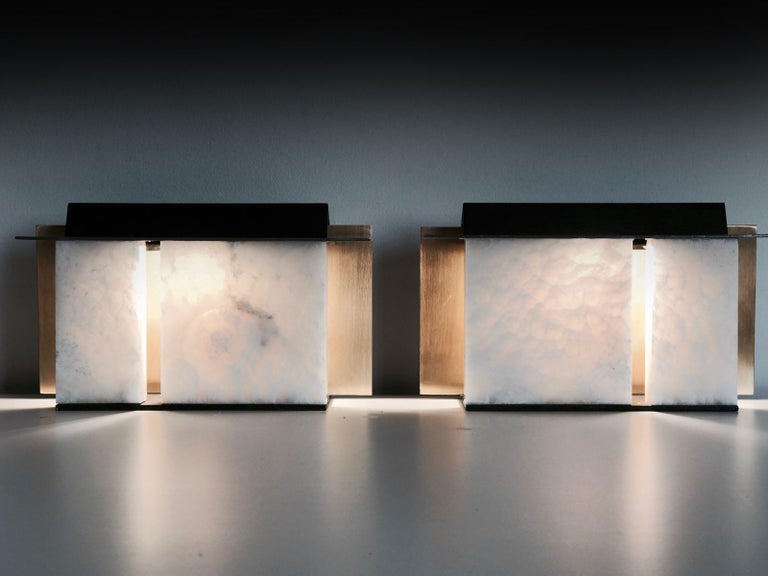 """Light board """" ISABENE """" Brass, PPH resin block white color, steel, black patina mirror Light bulb details: halogen 75mm Measures: L 200 mm, W 65 mm, H 130mm Available in other finishes and proportions . Quartz stone, Alabatre white all natural"""