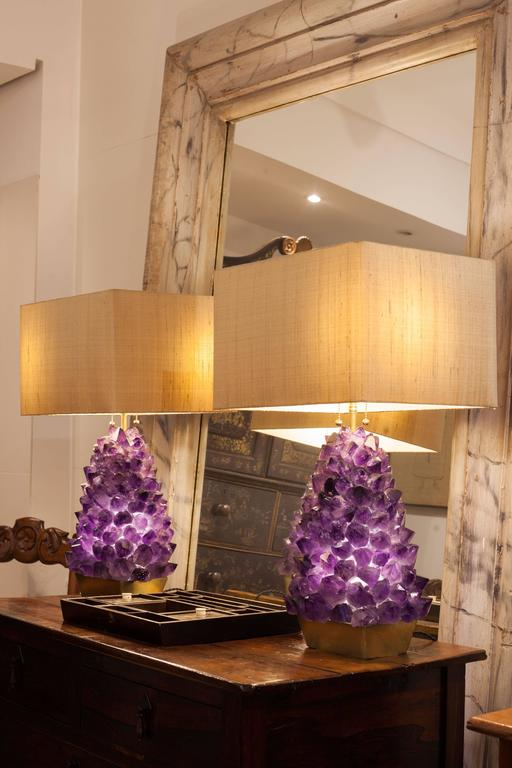 Unique pair of amethyst lamps, with approximately 170 brut rocks hand assembled on casted bronze base.  170 brut rocks. Weight: 14 kg. Internal 3,5W Led light and two external Led 9W lamps. Total 12,5 W on each with 3000K color tone. 127 V / 220