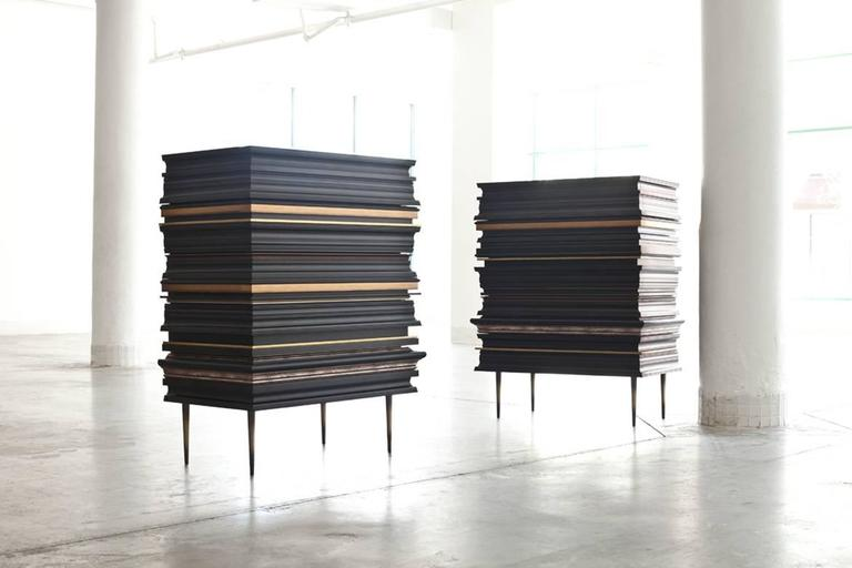 Pair of frame dressers by Luis Pons FRA-02 frame collection Design by Luis Pons limited edition, signed and numbered six drawers dresser featuring a walnut finish interior. Antique bronze steel legs. Dark finish frame segments with gold accents