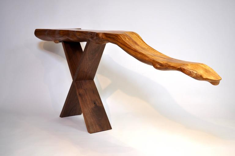Unique signed console by Jörg Pietschmann Console · Beech root, walnut  H 75 X W 194 x D 34 cm Curved piece of beech root on scissors stand of European walnut. Polished oil finish.   In Pietschmann's sculptures, trees that for centuries were part of
