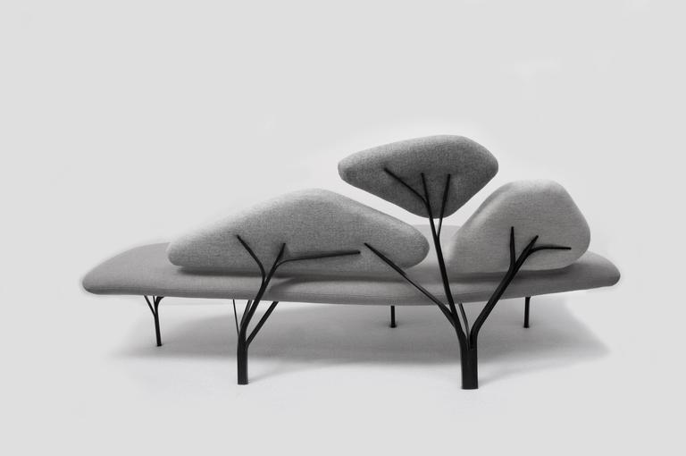Borghese is a light sofa inspired by the stone pines of the Villa Borghese gardens in Roma. The metal structure reproduces the network of branches and supports the back cushions; the whole draws a comfortable landscape.  Color scale : Borghese is
