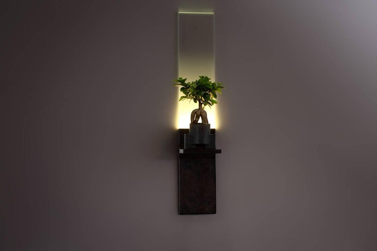 """The monolith, brass LED light plant grower, Luvere Studio Materials: Cold ? ?rolled ? ?steel, ? ?starfire ? ?glass, ? ?LED ? ?lighting Dimensions: 37"""" ? ?x ? ?7"""" ? ?x ? ?7""""  The monolith is a wall-mounted, full-spectrum LED light fixture"""
