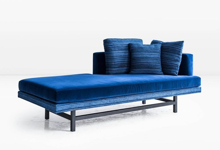 The Aragon has a powerful asymmetry which directs the view wherever it is placed. Also available as a sofa, sectional or ottoman. Shown in blue cotton velvet with linen and wool pillows on an ebonized walnut base. COM or COL (Customer's own fabric