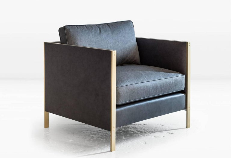 The architectural rigor of the Armstrong's mechanically fastened, metal frame forms a striking juxtaposition to the generously proportioned, down-filled seat and back cushions. Shown in leather and silk cotton with a brass frame. COM or COL Designed