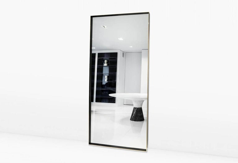 The simple purity of the Rone means it pairs beautifully with any piece in any setting. Shown with a solid Brass frame with patinated sides and burnished edges. Also available as a wall mirror in either a vertical or horizontal application or with a