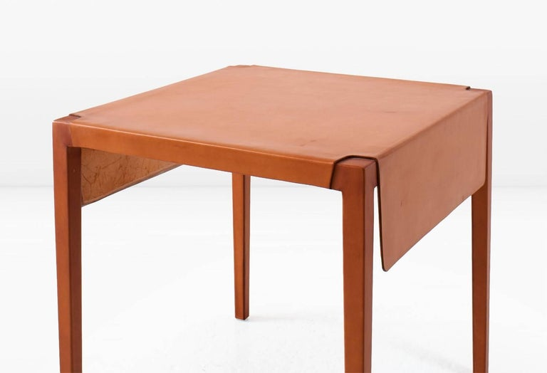 Utilizing a centuries old technique, water-saturated leather hide is molded and stretched over a maple frame to create the Emile Table. Shown in Russet leather. This piece is also available in other colors.  Designed and built by KGBL. Made to