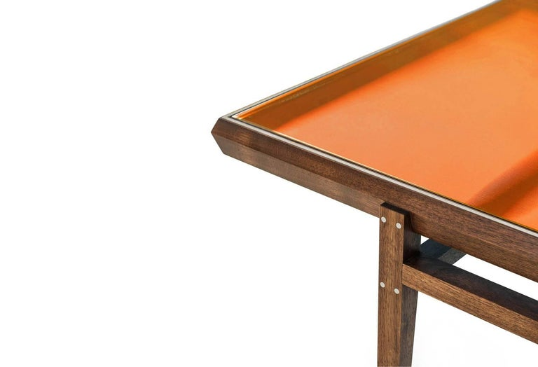 Modern Pintor Coffee Table, Walnut Frame with Stainless Steel Inlay, Orange Glass Top For Sale