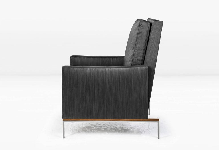 KGBL deconstructed the armchair to create the Larkin. Back and arms float away from a delicate metal and wood base. Semi-attached back and seat cushions are down filled for a supremely comfortable sit. Shown with nickel/teak base and silk cotton