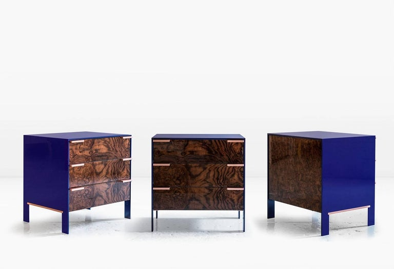 The Johansson cabinet, small has a skin of 1/2 inch lacquered aluminium encasing a cabinet constructed of highly polished wood veneer exteriors and solid wood interiors. Doors have solid metal pulls. Like all KGBL cabinetry, this piece is finished