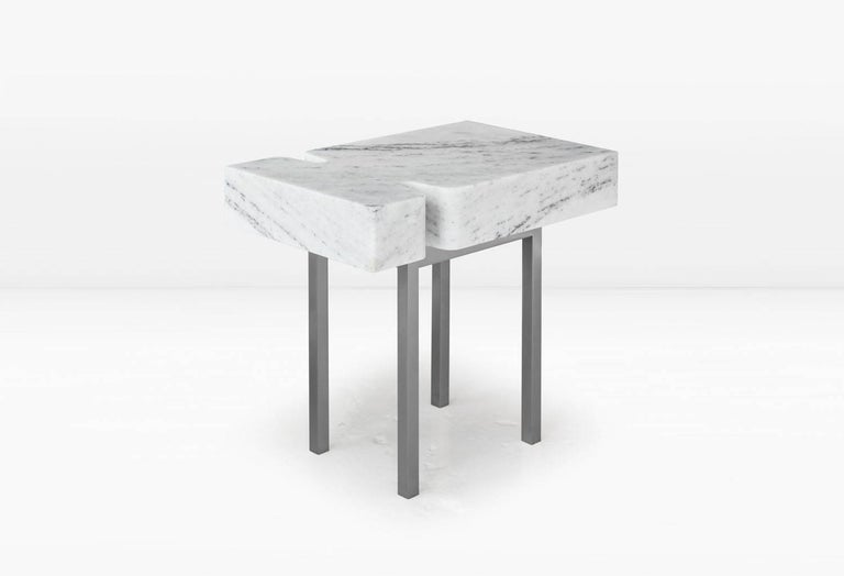 The terranova side table comprises the obverse of its companion piece, the Terranova coffee table, allowing the delicate base to feature more prominently. Shown with a statuary marble top and nickel base. Options include a white marble top as well