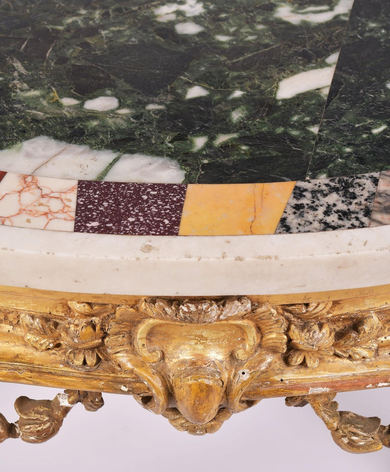 This Stunning 18th Century Carved Giltwood Console Table Features A Shaped Specimen Marble Top With Detailed