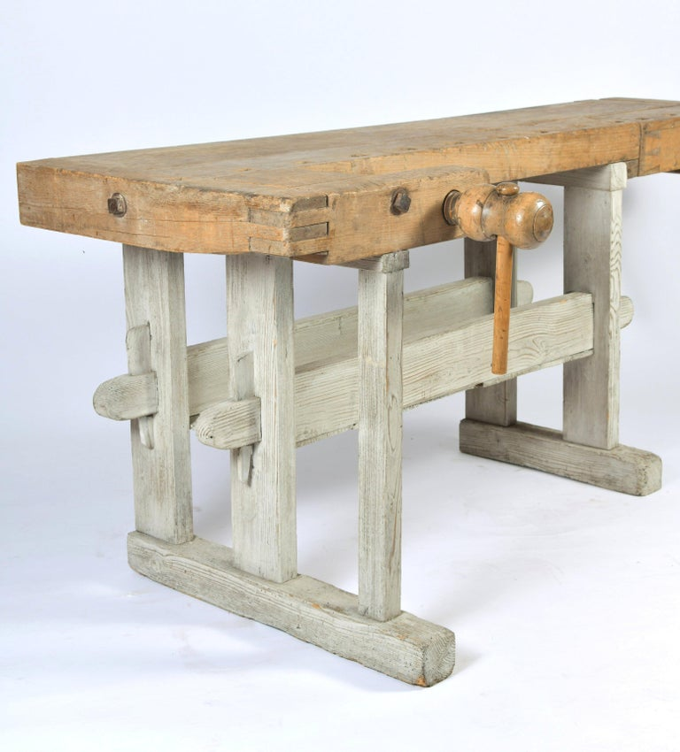 This fabulous Primitive wood workbench features a beechwood top with a painted white washed pine base. The maximum measurements including the screws are 81 in – 205.7 cm wide, 32 in – 81.2 cm deep and 31 3/4 in - 80.6 cm in height. The actual work