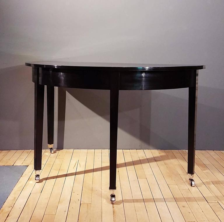 English Pair of Early 19th Century Ebonized Mahogany Demilune Console Tables For Sale