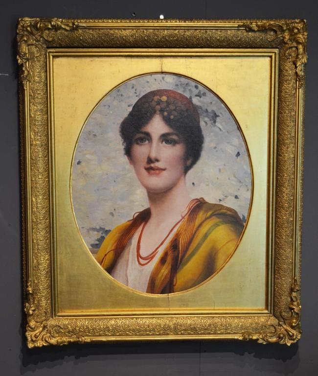 This lovely unsigned oil on canvas is a portrait of a young woman in the early part of the 20th century. The painting is circa 1930, and is surrounded by an earlier dated frame, circa 1890. The wood and gesso gilt frame is very deep and ornately