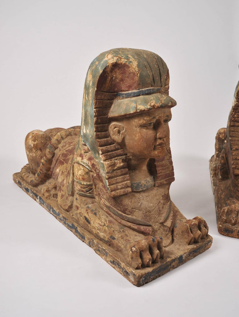 This highly decorative pair of sphinxes of carved wood with a painted plaster surface, is all in original un-restored condition. Each one measures 48 in - 122 cm deep, 17 ¾ in - 45 cm wide and 32 ½ in 82.5 cm in height. They would not only make a