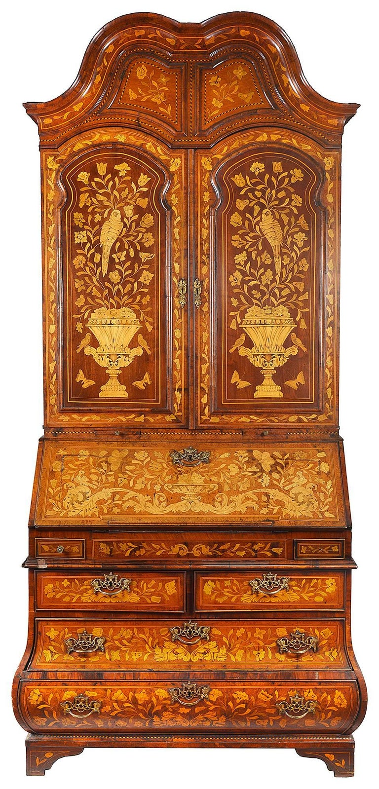 A very good quality 18th century Dutch marquetry inlaid bureau bookcase. Having a double dome top cornice, two panel doors, a fall front and bombe shaped base. The wonderfully bold and fine quality inlaid marquetry detail of flowers, birds and