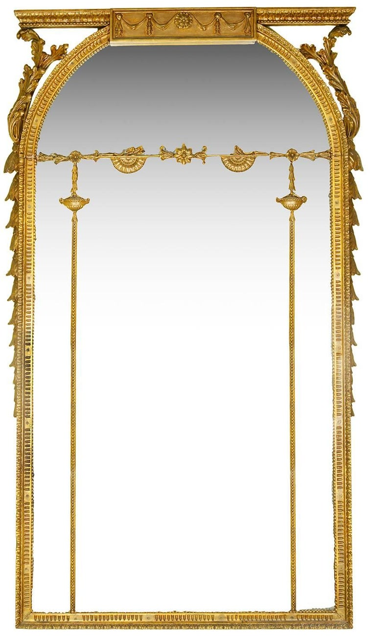 A large good quality pair of late 19th century gilded carved wood and gesso pier glass mirrors, having fluted and foliate decoration.