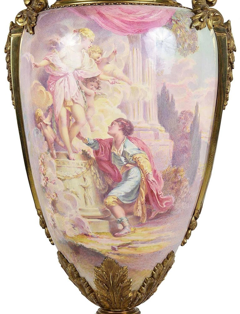 A wonderful quality large 19th century serves style porcelain lidded vase. Having gilded ormolu mounts, hand-painted romantic scenes with cobalt Blue and gilded boarders. Signed; Maxant.