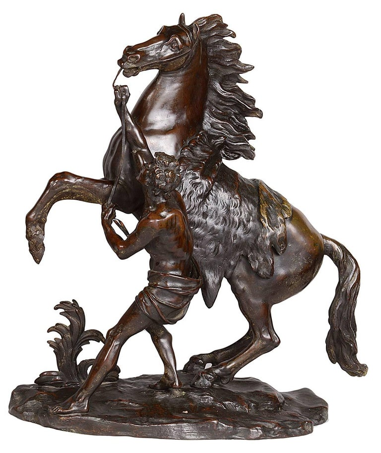 A very impressive pair of 19th century bronze Marley horse, having a good patina, after Guillaume Coustou the elder 1677-1746.