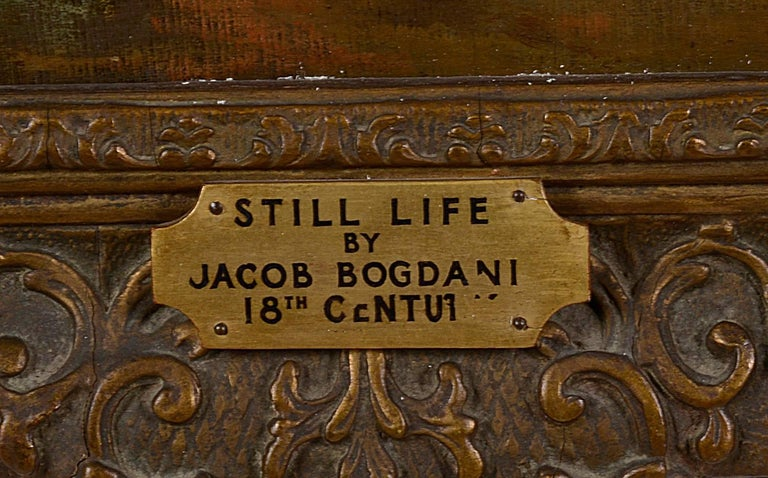 Hunting still life, oil on canvas, depicting a shot gun, and dead game beside a tree. Mounted in a carved and gilded gesso frame. Re-lined over 50 years ago. Jakob Bogdani, whose names are sometimes spelt Jacob and Bogdany, was a Slovak and