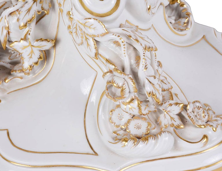 A very good quality pair of 19th century, German Meissen white porcelain four branch candelabra. Each having gilded highlights to the leaf and floral decoration.