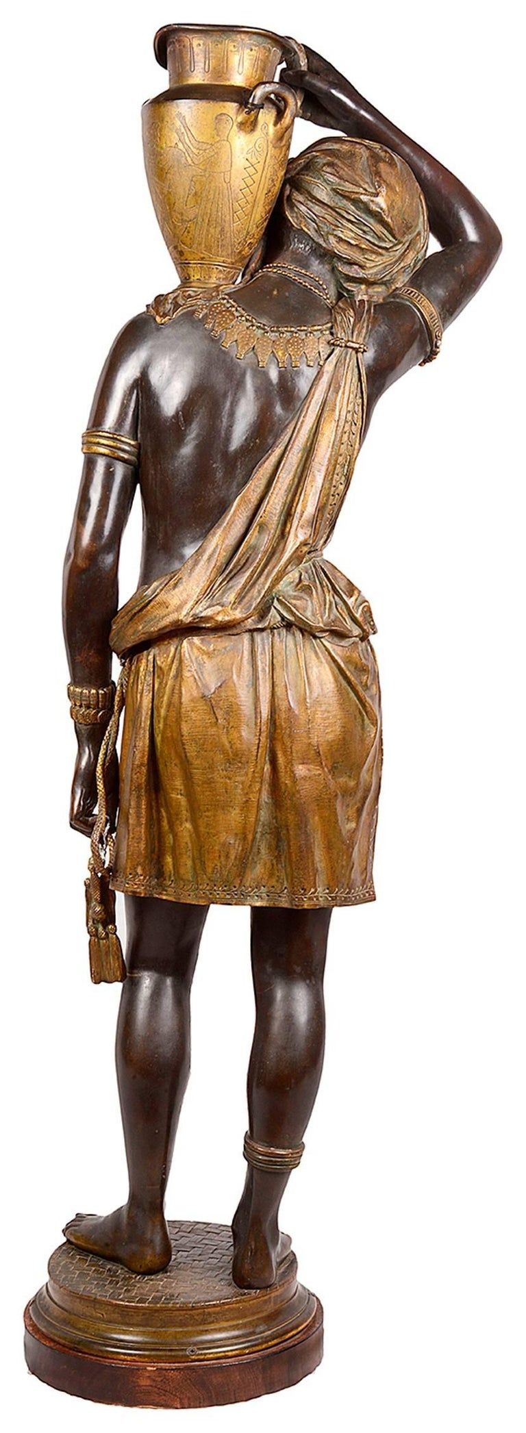 A very good quality large 19th century bronze and gilded Nubian figure carrying and water jug. Signed; Graux-Marly, foundry.