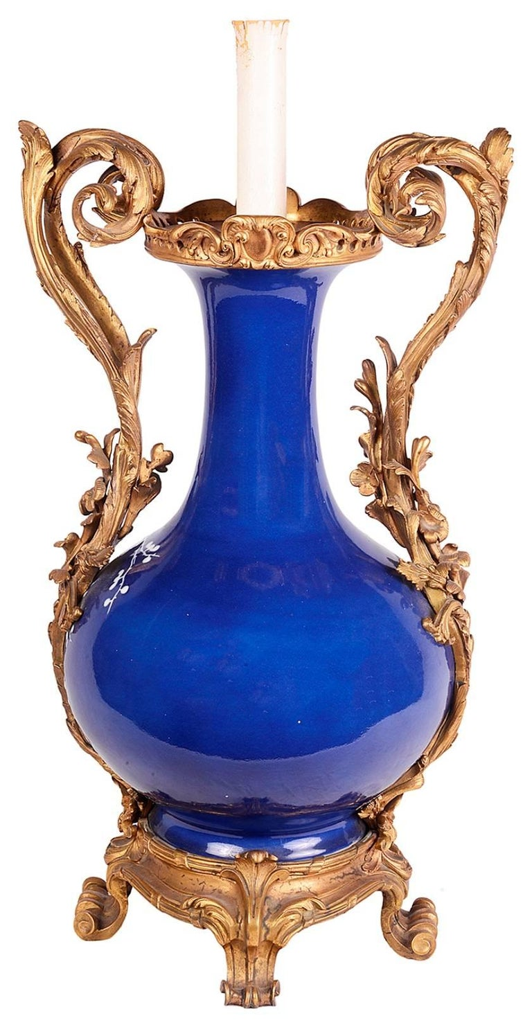 A striking Chinese Blue and White vase, having French scrolling foliate ormolu mounts and handles. Converted to a lamp.