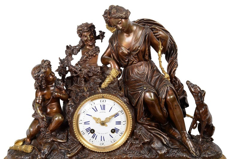 A large and impressive, good quality 19th century French Louis XVI style gilded ormolu and bronze clock set. Having a mother and child mounted above the clock, which has an eight day, hour and half hour striking movement, signed; Guiche, Palais