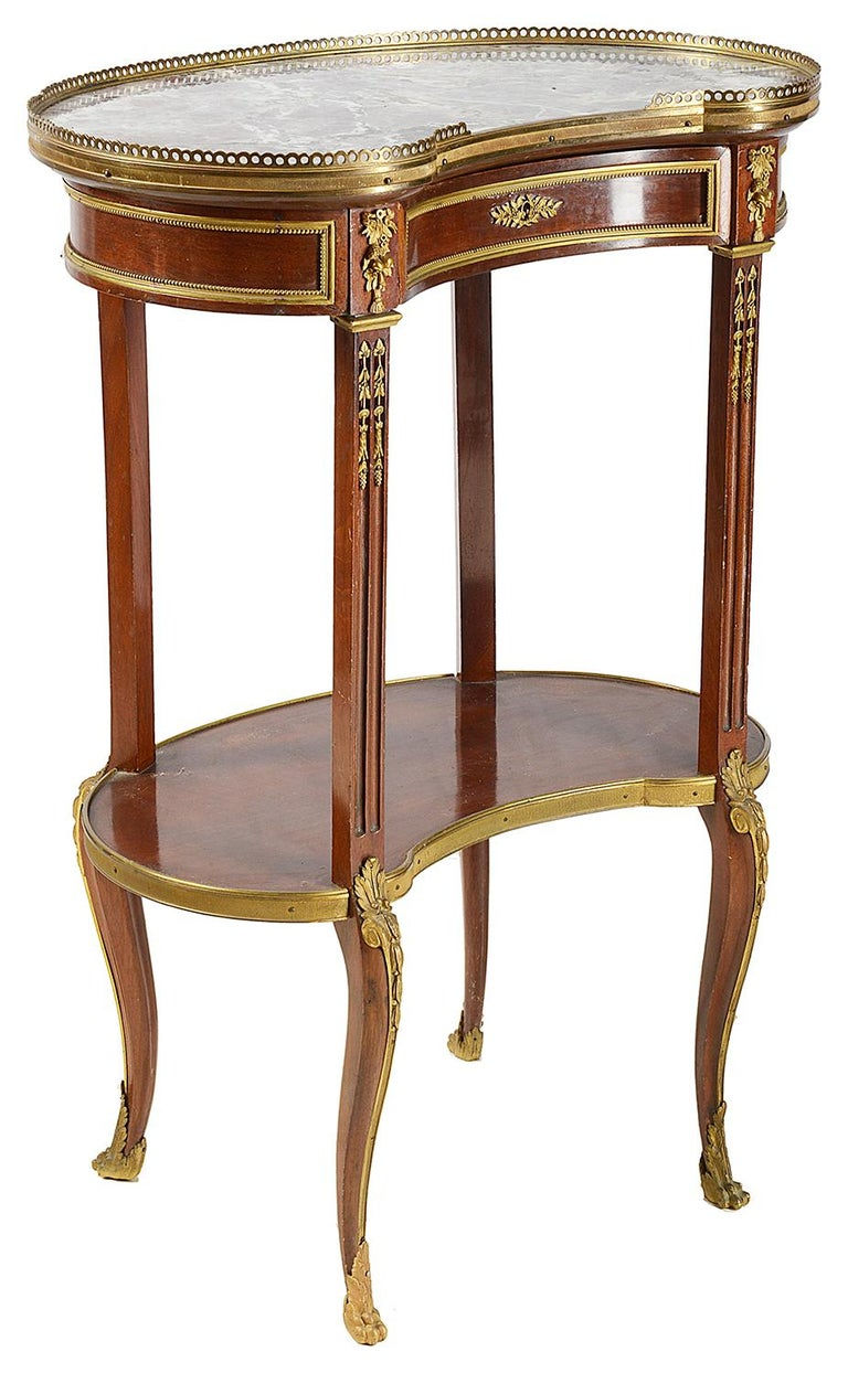 A pair of good quality late 19th century Louis XVI style marble topped side tables. Each with a frieze drawer, gilded ormolu mounts, an under-tier and raised on elegant cabriole legs.