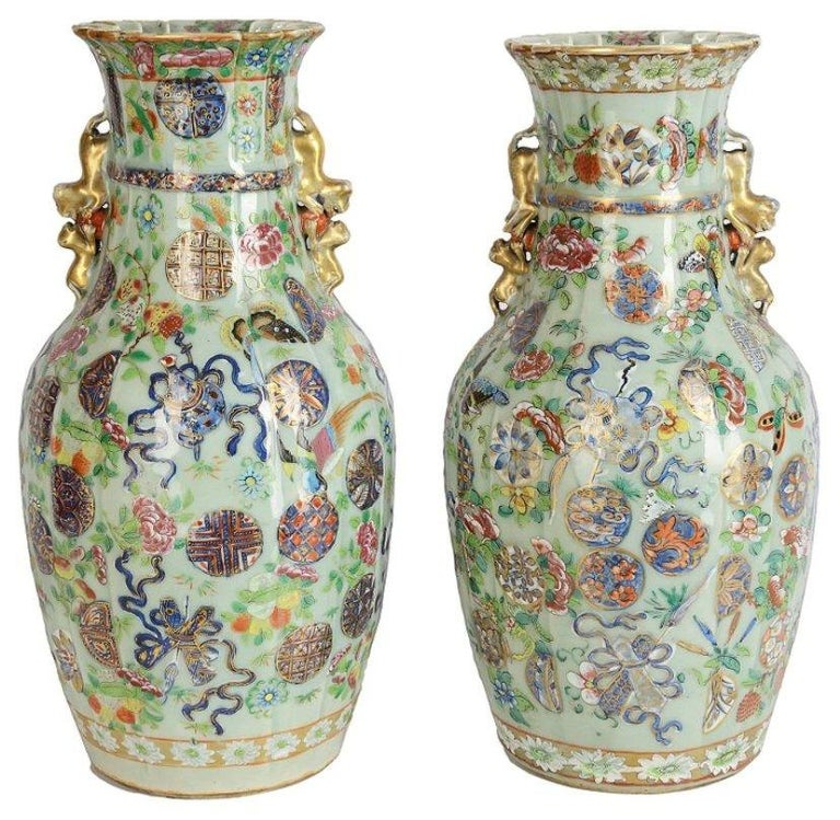 A good quality near pair of 19th century Chinese Celadon / rose medallion vases / lamps. Having a pleated form to the necks and body, gilded dog of faux handles to both. Classical motif, ribbon and floral decoration.
