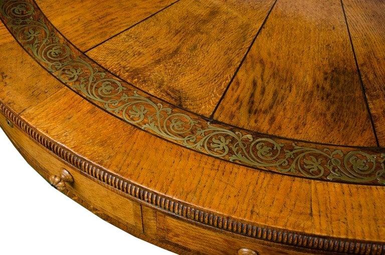 Brass Regency period, Pollard Oak Drum table, 1820 For Sale