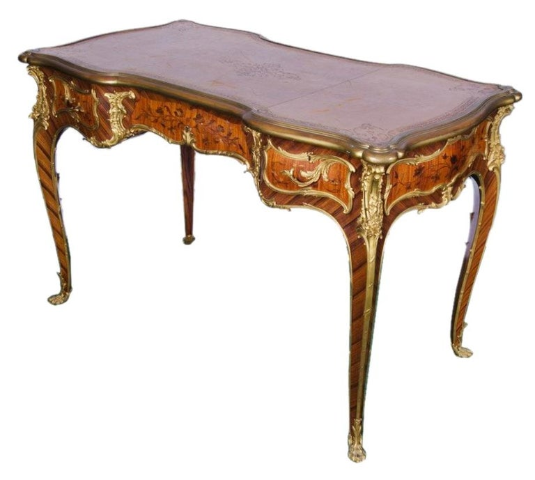 A fine quality French kingwood and marquetry, ormolu-mounted Bureau plat, signed Linke.