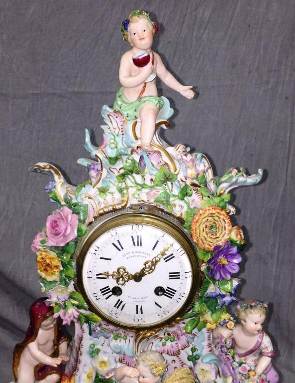 A very good quality 19th century Meissen Porcelain mantel clock, depicting children representing the Four Seasons amongst flowers and C-scrolls. Having an eight day striking movement with the retails name;