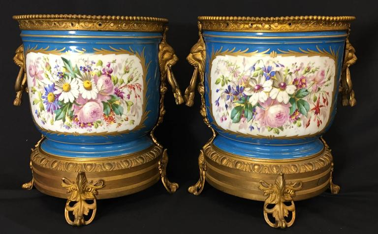 A good quality pair of French Sèvres Porcelain, ormolu-mounted jardinieres, depicting romantic scenes and floral panels.