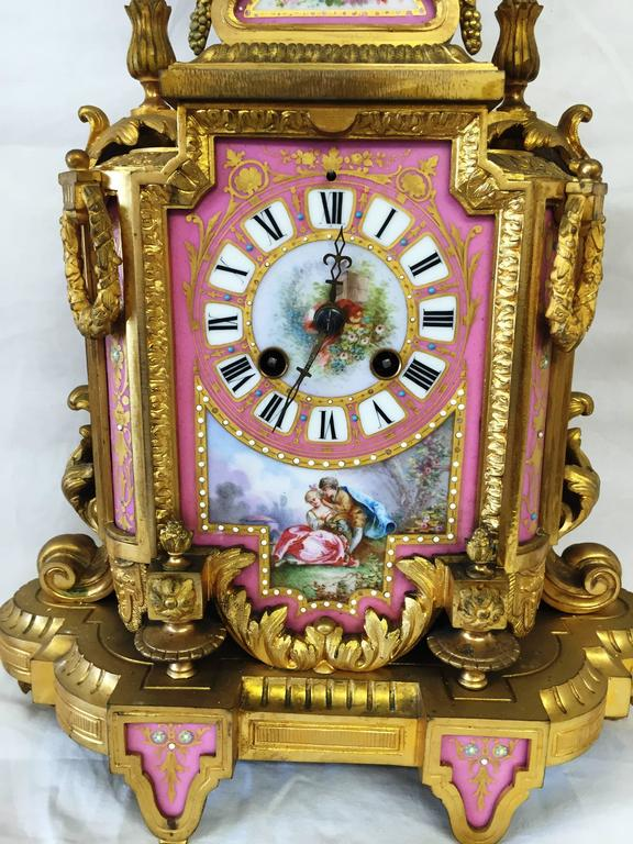 Cast 19th Century French Sevres Porcelain Clock Set For Sale